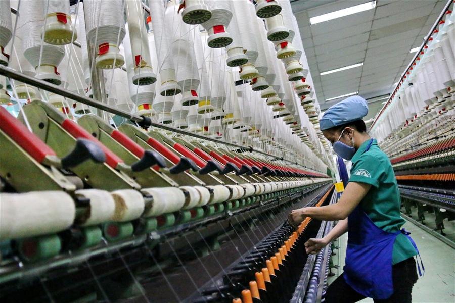Xuất khẩu dệt may tăng trưởng trong khó khăn